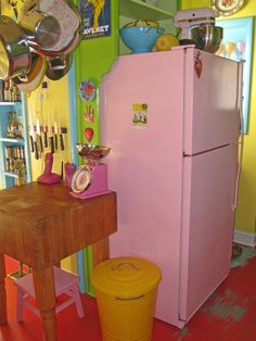 I love how they took an old standard refrigerator and painted it pink! Love this!