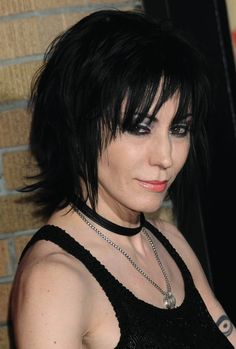 Joan Jett:  I went to high school with her...so I know she's well over 50! lol