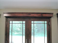 Cornice boards over French Doors. Handmade to match the texture and color of surrounding wood trim.
