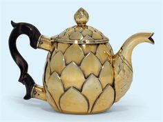 A CONTINENTAL SILVER-GILT TEA-POT APPARENTLY UNMARKED, MID-18TH CENTURY In the form of an artichoke, the hinged cover with an artichoke finial, with a wood handle and a part-facetted spout. Christies