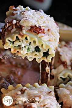 Lasagna Roll Ups: Delicious spinach and cheese rolled up and topped with meat sauce and mozzarella! This dish cooks up quickly and is always a hit!