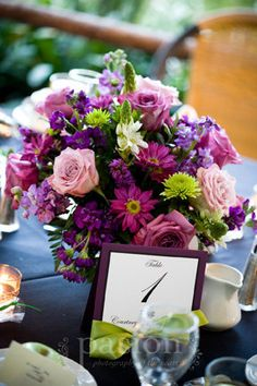 purple and green flowers would be great for a fall wedding