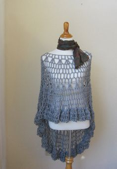 Beautiful handmade poncho - capelet .That falls elegantly over the shoulders.. Keeps you warm and beautiful.  American size. Small, medium, large .  Measures : In front is 19 inch long, in the back is 38 inch.  Care instructions: Gently hand wash in cold water with mild soap and lay flat to dry.  Crocheting in a clean smoke-free studio (no smoke or pet odors either).  This is an original design, handmade with great care and love by yours .