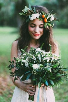 """This Bouquet Exhibits A """"Tropical"""" Feel, & Is Arranged With White Florals Such As Veronica Flower, Delphinium, Freesia, & Ranunculus + Deep Emerald Green Foliages. Bride Wears A Coordinating Floral Crown****"""