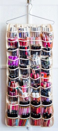 A woman can NEVER have too much lip gloss! Great Idea for storage - lip stick organizer
