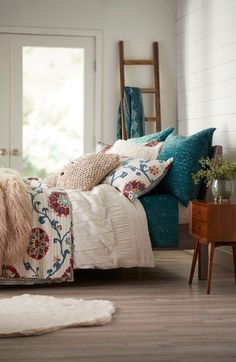 Mixed pleats and ribbons create understated textural intrigue on a cotton duvet cover that coordinates with a wide range of bedroom décor.