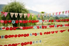 String brightly-colored escort cards across clothes lines strung at different heights to create a whimsical display. Select fun shapes and bold colors to add to the awe-worthy presentation!Photo Credit: Anna Hedges on Southern Weddings via Lover.ly
