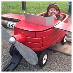 Amelia Earhart Halloween costume. Turned the wagon into an airplane. :)