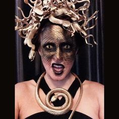 Medusa Halloween costume. Used toy snakes wrapped to a headband, spray painted gold. Fishnet over face to create scale make up. #medusa #halloween #makeup