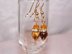 Gold tone dangles with a genuine Tiger Eye and Amber Swarovski Crystal. Crystal Spacer ..