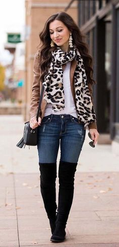 #winter #outfits women's brown jacket, animal-printed scarf, and blue-washed jeans. Click To Shop This Look.