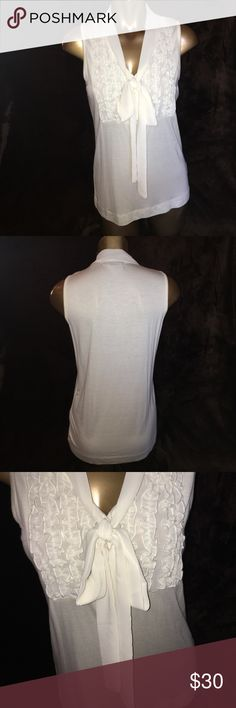 Cream colored tie front with ruffles top Cream colored top. Tie front with buttons and ruffles. NWT august silk Tops Tank Tops