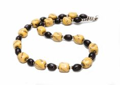 Golden Sunflower. Let your beauty light up the room just like a sunflower when you wear this piece around your neck. Handcrafted with joy in the Kazuri women's cooperative in Nairobi, Kenya using the clay of Mt. Kenya. Certified Fair Trade. 18 inch length.
