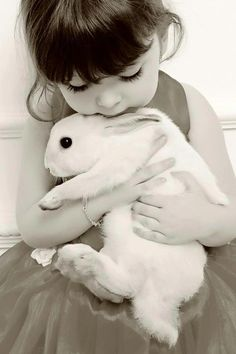 I have a photo of my son this age with his rabbit. Same pose. This is cute..