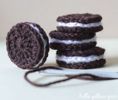 I have an easy, quick and fun crochet tutorial for you today! These cream filled biscuits look great and they make great play food toys for kids. You can also add magnets to the back a… Toys Patterns play food How to Crochet Amigurumi Food Crochet Amigurumi, Crochet Food, Crochet Kitchen, Cute Crochet, Crochet Crafts, Crochet Dolls, Crochet Yarn, Easy Crochet, Crochet Projects