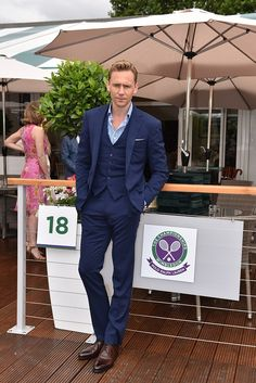 Dashing gentleman: Actor Tom Hiddleston looked dashin in a Ralph Lauren purple label suit,...