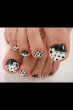 Black and white polka dot pedicure nail design