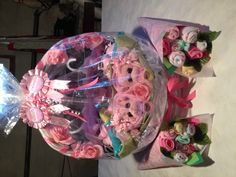 TWINS! Baby shower gift..Two piglets in a pod!.. Dollar store: green pillow case, two piglet stuffed animals, two pink baby blankets... The bouquets are four packages of baby wash clothes, shaped to look like flowers! Green paper leaves, tissue paper wrapping.. Love how this came out!!