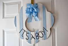 TOO CUTE! Wooden door wreath. She also has them for girls. $20