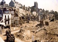A US Convoy passes through a ruined St Lo just below the Citadel