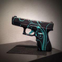 Custom Glock with Cerakote script pattern in Robin's Egg Blue and Graphite Black. #fortheladies #glock #cerakote
