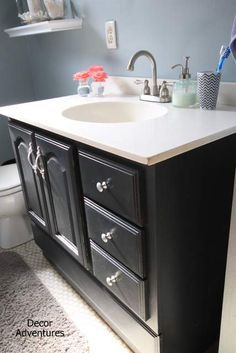Bathroom Vanity Makeover. Give that old builder-grade oak vanity an upgrade with chalk paint and poly in a few easy steps.
