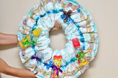 How to Make a Diaper Wreath -- via wikiHow.com   Fun gift to make for a baby shower.