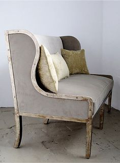 AGED WOOD FRAME LOVESEAT. I like how this piece is accented with modern pillows and colors. Nice combination with the weathered wood frame.