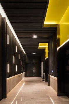 © Seth Powers. COSMO - a four story sales center for a residential complex in Chengdu, China. Designed by Ian Douglas-Jones of Atelier I-N-D-J. Hallway.