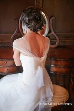 Structured updo. Bridal hair and makeup by: www.danielarodrigueznyc.com
