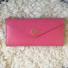 Pink Tory Burch Wallet 100% authentic! Good condition. Few minor cracks in leather. No cracks or tears in card slots. Snaps all working. No pen marks or stains. Genuine saffiano leather. Small mark, barely noticeable. Logo in good condition. Minimal scratching. Detachable brown change pouch. No trades//No PayPal. Tory Burch Bags Wallets