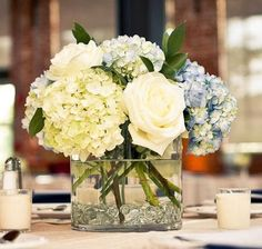 hydrangeas and roses in clear square short vases