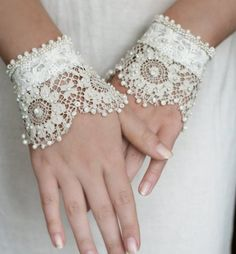 blanche-antique-lace-wrist-cuffs.   This would be beautiful on a bride with slender arms and a very modest but elegant wedding gown.