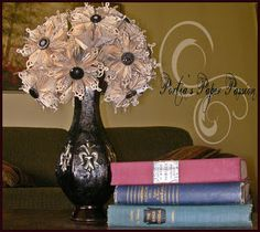 Hand-crafted flower bouquet made from book pages and adorned with vintage buttons