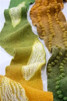 inspired knitting by Jeung-Hwa Park;  Using shibori techniques with knitted, felted, and hand dyed pieces,   she creates these gorgeous fluid and harmonic pieces of wearable art.