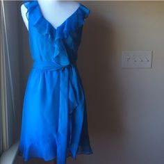Blue ruffle dress Johnny Martin blue ruffle dress. Size 5. Side zipper with sash/tie. If you look really closely in the last pic there is a slight stain on the ruffle. Really not noticeable at all. Gorgeous color!!  Johhny Martin Dresses Mini
