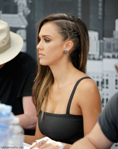 "Beautiful Jessica Alba with side swept hair with side braid hairstyle at the ""Sin City: A Dame to Kill For"" panel during Comic-Con International 2014."
