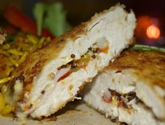 """Chicken """"façon cordon-bleu"""" filled with ham, tomatoes, onions, oka cheese, and mustard, and coated with bread crumbs"""