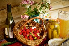 Rustic, simple, wooden planks, bright tablecloths, wildflowers.