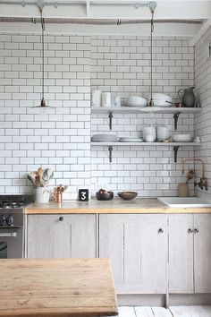 Isn't this kitchen just dreamy - the clean bright Metro tiles against the natural woods of the kitchen units works so well - I want this kitchen!