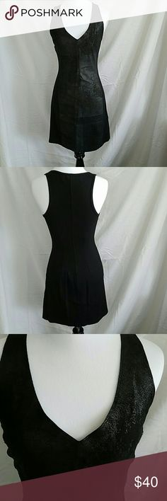 PRICE DROP! Grahm and Spencer Cocktail Dress Black with leather patching in front plunging neckline with leather detail with clothes sides Size Petite Bust 30 waist 28 75% rayon  19% nylon 6% spandex  100% leather Graham & Spencer Dresses Midi