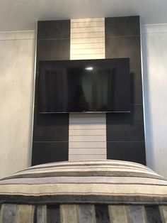 Living Room feature tiled chimney with contrasting stick tiles running vertically.