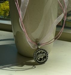 Native American Bear Image Medallion on Ribbon Necklace by Art in Oregon. $12.00, via Etsy.