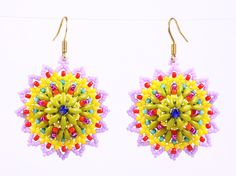 Three dimensional mandala woven with twin beads and seed beads in bright colors. A symphony of lime green, bright yellow, playful magenta, tomato red, light lavender, Mexican turquoise and just a touch of navy blue creates a dome circle edging with tiny picots. Gold color metal. Handmade in USA.  Diameter: 1 3/8  Other color combinations are available upon request.  No shipping charges on all items in the store.