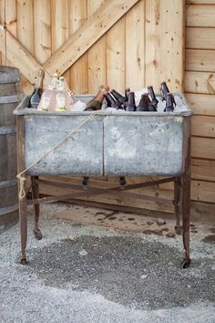 Old galvanized buckets on stand, perfect for keeping those drinks cold.