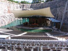 Dalhalla, an open-air stage and established international arena, in a disused quarry called Draggängarna, in the woods outside Rättvik in Dalarna, Sweden. Described as one of the most powerful and most beautiful outdoor venues in the world. Lime quarry dimensions: 400m x 175m x 55m. The lake is about 2.2 m deep on average, receives its emerald green color from small limestone particles in the water which is broken by the light.
