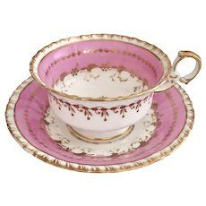 Minton teacup and saucer, overglaze pink on K-shape, 1825-1830