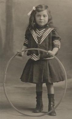 Antique French CDV photo, pretty little brunette girl in a sailor suit, posing with a toy hoop.