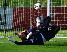 Joe Hart of England in action during a training session at St Georges Park on October 8, 2013 in Burton-upon-Trent, England