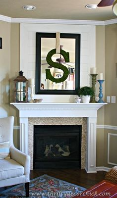love what she did with this corner fireplace and especially the board backing at the top